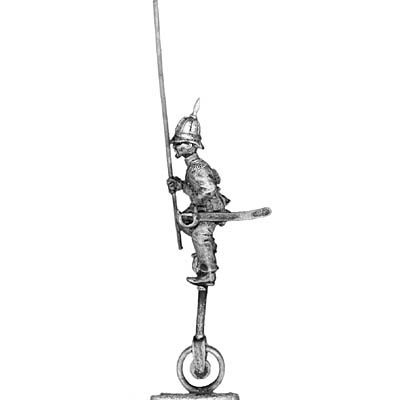 Standard bearer on unicycle in pith helmet